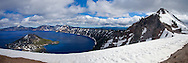 Even in July, snow covers the rim of Crater Lake.  Formed in the caldera of an extinct volcano, it is the deepest lake in the United States.  This depth accounts for the rich blue color of the water.