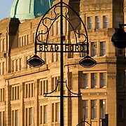 Decorative street lamp on Bridge Street, spelling the word Bradford; Britannia House in the background.