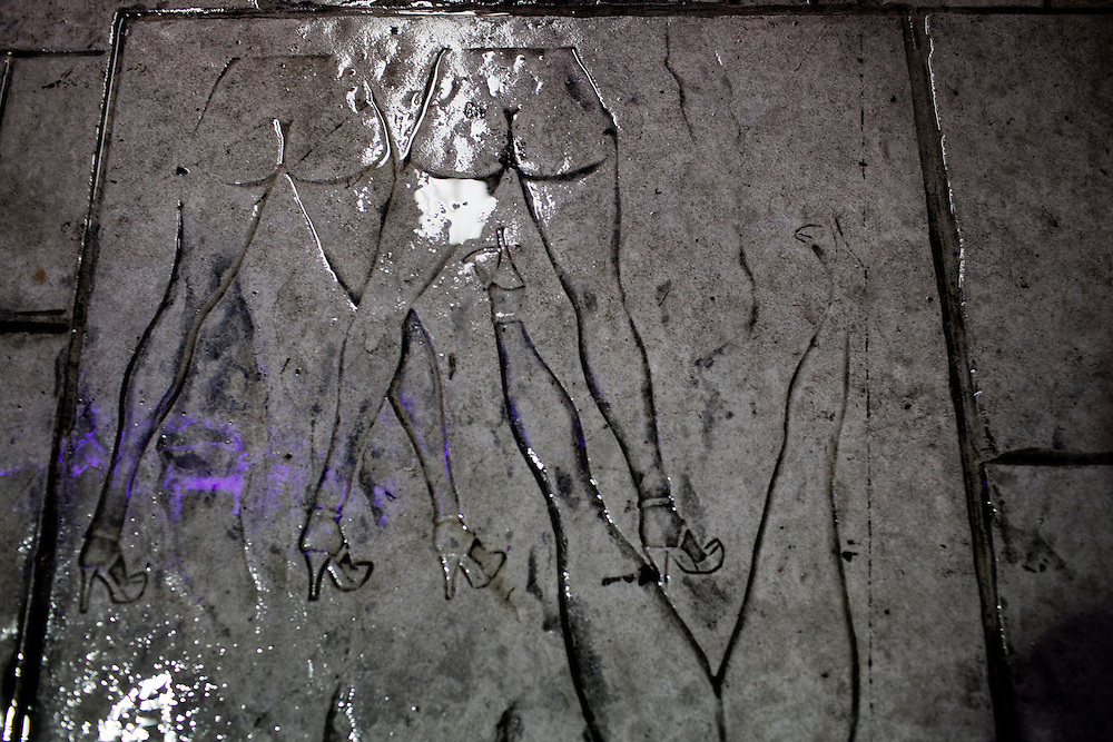 Etchings of nude women in the concrete outside the world famous Mons Venus strip club in Tampa, Florida.