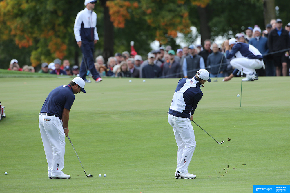 Ryder Cup 2016.  Jordan Spieth and Patrick Reed of the United States during practice day in front of massive crowds at the Hazeltine National Golf Club on September 28, 2016 in Chaska, Minnesota.  (Photo by Tim Clayton/Corbis via Getty Images)