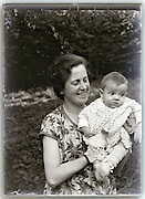 happy mother holding baby 1930s
