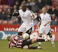 Photo: Aidan Ellis.<br /> Sheffield United v Swansea City. The FA Cup. 06/01/2007.<br /> Swansea's Adebayo Akinfenwa tangles with Sheffield's Derek Geary