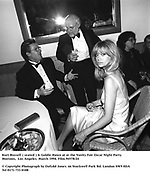 Kurt Russell ( seated ) & Goldie Hawn at at the Vanity Fair Oscar Night Party Mortons,  Los Angeles. March 1994. Film.94578/24<br />