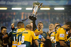 Northampton Winger George North holds the trophy up after his sides victory - mandatory by-line: Rogan Thomson/JMP - Tel: 07966 386802 - 23/05/2014 - SPORT - RUGBY UNION - Cardiff Arms Park, Wales - Bath Rugby v Northampton Saints - Amlin Challenge Cup Final.