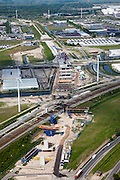 Nederland, Amsterdam, Westpoort, 25-05-2010. Aanleg Westrandweg ter hoogte van Noordzeeweg/Basisweg. De nieuwe weg zal aansluiten op Tweede Coentunnel. .Construction Westrandweg, the new road will connect to the new Coen tunnel..luchtfoto (toeslag), aerial photo (additional fee required).foto/photo Siebe Swart