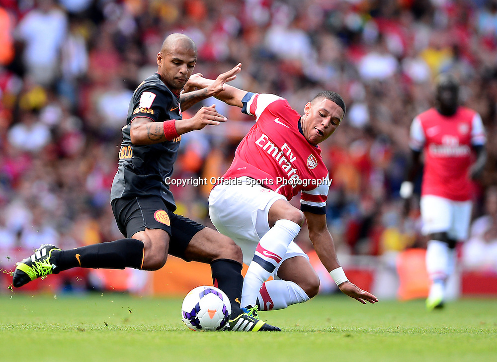 4th August 2013 - Emirates Cup - Arsenal v Galatasary - Alex Oxlade-Chamberlain of Arsenal tangles with Felipe Melo of Galatasaray - Photo: Marc Atkins / Offside.