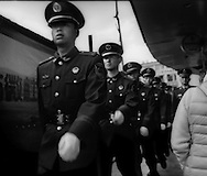 Police marking on the streets of Lijiang.  Yunnan, China.  A heavy police presence is a permanent feature of cities in the Peoples Republic of China.