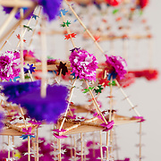 Traditional straw spiders crafted by old folk artist Maria Lasota to decorate interiors