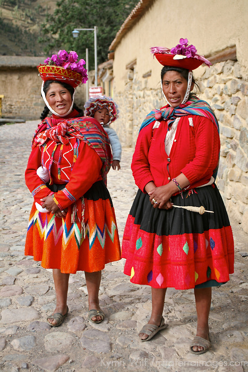 Americas, South America, Peru, Ollanta. Two women, one with baby, sing in hopes of handouts from tourists.