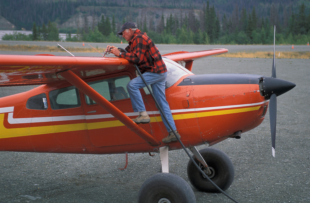 John Claus fueling Airplane, Ultima Thule Lodge, Wrangell St. Elias National Park, Alaska, USA