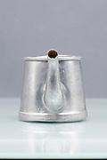 silver colored small one person coffee pot