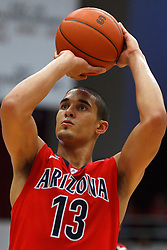 Feb 4, 2012; Stanford CA, USA; Arizona Wildcats guard Nick Johnson (13) shoots a free throw against the Stanford Cardinal during the second half at Maples Pavilion.  Arizona defeated Stanford 56-43. Mandatory Credit: Jason O. Watson-US PRESSWIRE