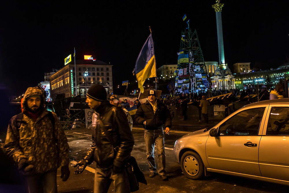 KIEV, UKRAINE - DECEMBER 3: Protesters rally in Independence Square on December 3, 2013 in Kiev, Ukraine. Thousands of people have been protesting against the government since a decision by Ukrainian president Viktor Yanukovych to suspend a trade and partnership agreement with the European Union in favor of incentives from Russia. (Photo by Brendan Hoffman/Getty Images) *** Local Caption ***