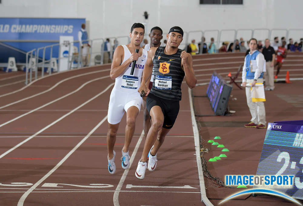 Mar 10, 2018; College Station, TX, USA; Michael Norman of Southern California defeats Benjamin Vedel of Florida on the anchor leg of the Trojans 4 x 400m relay that won in a world record 3:00.77 during the NCAA Indoor Track and Field Championships at the McFerrin Athletic Center.