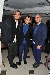 Left to right, designers CHRISTOPHER DE VOS, PETER PILOTTO and RICHARD NICOLL at a party hosted by TopShop to celebrate 10 years of NEWGEN and 10 years of supporting Brtish Fashion held at Le Baron, 29 Old Burlington Street, London W1 on 21st February 2012.
