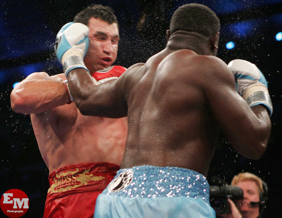 Wladimir Klitschko (l) and Samuel Peter (r) trade punches during their fight.