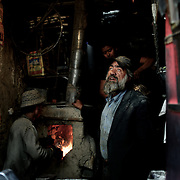November 15, 2012 - Kabul, Afghanistan: A family of blacksmiths makes knifes and blades to be used during Ashura festival, in a workshop at the bird's bazaar in central Kabul. (Paulo Nunes dos Santos)