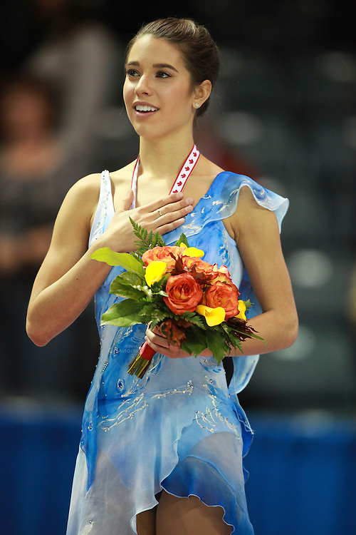 20101030 -- Kingston, Ontario -- Gold medalist Alissa Czisny of the United States sings the national anthem during the medal ceremony for the ladies competition at Skate Canada International in Kingston, Ontario, Canada, October 30, 2010. <br /> AFP PHOTO/Geoff Robins