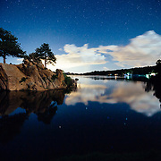 Campsites over Granite Springs Resevoir after dark with a star filled sky.