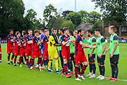 Teams line up during the Pre-Season Friendly match between Hampton & Richmond and AFC Wimbledon at Beveree Stadium, Richmond Upon Thames, United Kingdom on 27 July 2019.