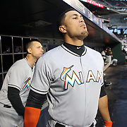 NEW YORK, NEW YORK - APRIL 11: Giancarlo Stanton, Miami Marlins, watching play from the dugout as he prepares to bat during the Miami Marlins Vs New York Mets MLB regular season ball game at Citi Field on April 11, 2016 in New York City. (Photo by Tim Clayton/Corbis via Getty Images)