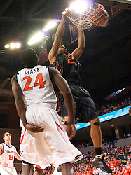 Miami (FL) forward Cyrus McGowan (20) dunks in front of Virginia guard/forward Mamadi Diane (24).  The Virginia Cavaliers fell to the Miami Hurricanes 62-55 at the John Paul Jones Arena on the Grounds of the University of Virginia in Charlottesville, VA on February 26, 2009.