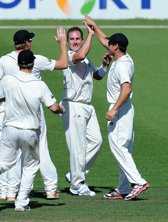 New Zealand's Mark Gillespie, centre, with his team mates after dismissing South Africa's Jacques Rudolph for 1 on the second day of the second International Cricket Test, Seddon Park, Hamilton, New Zealand, Friday, March 16, 2012. Credit:SNPA / Ross Setford