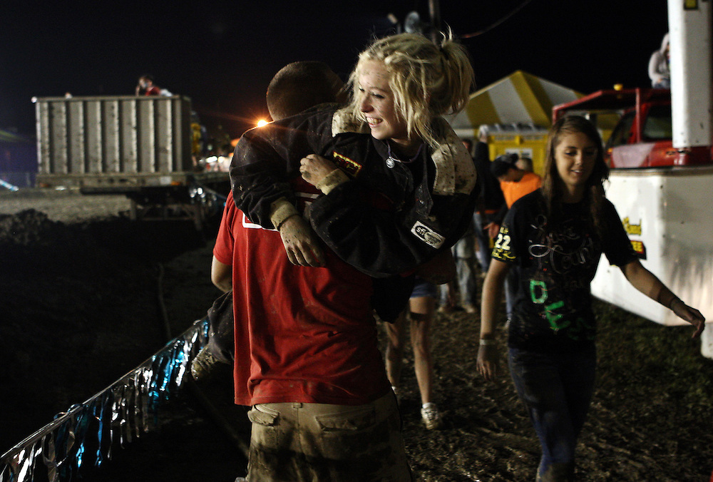 Taylor finished fourth in her heat and advanced to the next round of the demolition derby at the Lake County Fair in Crown Point on Saturday August, 13, 2011. She is congratulated by family friend Dillon Meadows.
