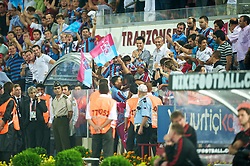 TRABZON, TURKEY - Thursday, August 26, 2010: Trabzonspor's Teofilo Gutierrez celebrates scoring the opening goal against Liverpool by running into the crowd to kiss his partner during the UEFA Europa League Play-Off 2nd Leg match at the Huseyin Avni Aker Stadium. (Pic by: David Rawcliffe/Propaganda)