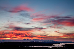 North America, United States, Washington, Seattle, Lake Washington, I90 bridge, downtown skyline and Olympic Mountains viewed from Bellevue at sunset