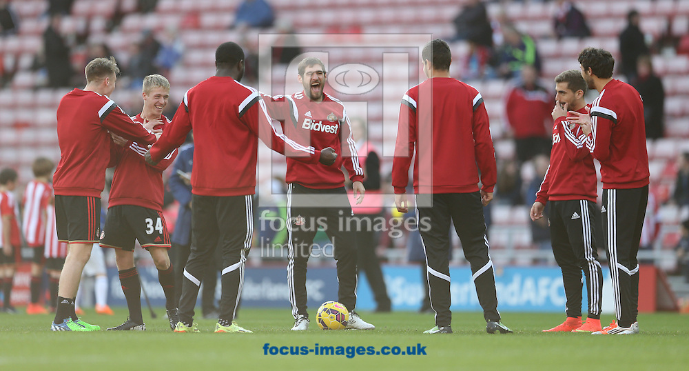 The Sunderland bench enjoy a laugh warming up prior to the Barclays Premier League match at the Stadium Of Light, Sunderland<br /> Picture by Simon Moore/Focus Images Ltd 07807 671782<br /> 09/11/2014