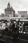 PIC BY HOWARD BARLOW..PAUL McCARTNEY & WINGS, Photo-shoot on ferry on the River Mersey, Liverpool 1979