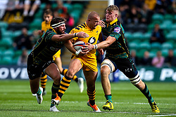 Tom Cruse of Wasps is tackled by Tom Wood and Ollie Sleightholme of Northampton Saints - Mandatory by-line: Robbie Stephenson/JMP - 28/09/2019 - RUGBY - Franklin's Gardens - Northampton, England - Northampton Saints v Wasps - Premiership Rugby Cup
