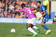 Andy Barcham of AFC Wimbledon and Andy Yiadom during the Sky Bet League 2 match between AFC Wimbledon and Barnet at the Cherry Red Records Stadium, Kingston, England on 3 October 2015. Photo by Stuart Butcher.