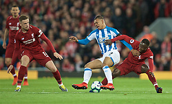 LIVERPOOL, ENGLAND - Friday, April 26, 2019: Liverpool's captain Jordan Henderson (L), Naby Keita (R) and Huddersfield Town's Juninho Bacuna (C) during the FA Premier League match between Liverpool FC and Huddersfield Town AFC at Anfield. (Pic by David Rawcliffe/Propaganda)