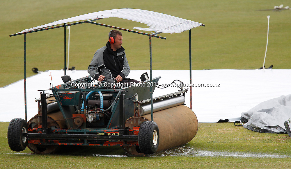 The super sopper roller takes care of excess water before play during the HRV Cup Cricket Twenty-20,  Auckland Aces v Wellington Firebirds, Colin Maiden Park Auckland, Sunday 18 December 2011. Photo: Simon Watts/www.photosport.co.nz