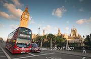 London bus on Westminster Bridge, Big Ben and the Houses of Parliament in London, England.