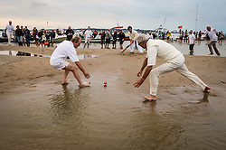 Match action during the annual Bramble Bank cricket match between the Royal Southern Yacht Club and the Island Sailing Club of Cowes, which takes place on a sandbank in the middle of the Solent.