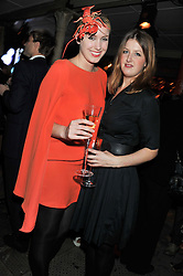 Left to right, OLIVIA von HALLE and CATHERINE BECKER at a party to celebrate the launch of the new Vertu Constellation phone - the luxury phonemakers first touchscreen handset, held at the Farmiloe Building, St.John Street, Clarkenwell, London on 24th November 2011.