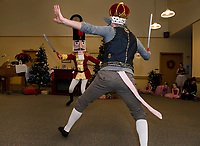 Eliza Carter the Nutcracker duels with John Pina the Rat King during a scene of The Nutcracker with Lakes Region Dance performed at the Taylor Home on Monday evening.  (Karen Bobotas/for the Laconia Daily Sun)