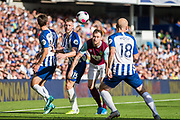 Adam Webster (Brighton) heading the ball away from Ashley Barnes (Burnley) during the Premier League match between Brighton and Hove Albion and Burnley at the American Express Community Stadium, Brighton and Hove, England on 14 September 2019.