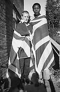 Lee and Felix with a Union Jack, High Wycombe, UK, 1980s.