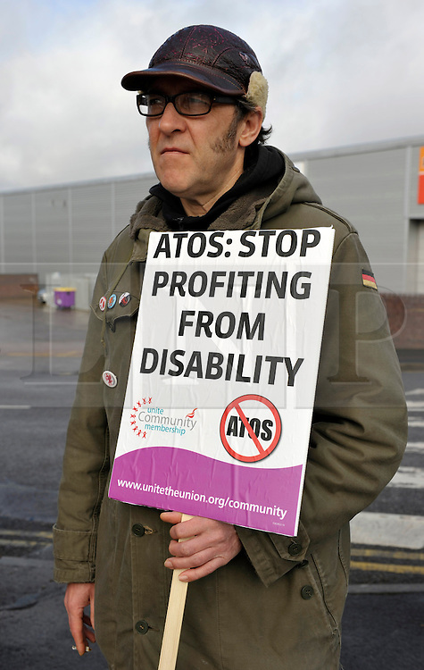 """© Licensed to London News Pictures. 19/02/2014; Bristol, UK.  Protest at Bristol Assessment Centre, Government Buildings, Flowers Hill, Brislington, Bristol, against ATOS Healthcare who carry out millions of """"fit-for-work"""" tests for sick and disabled benefit claimants on behalf of the UK Government.  It is reported that the Government will terminate the contract with ATOS.<br /> Photo credit: Simon Chapman/LNP"""