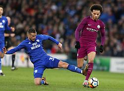 Cardiff City's Joe Bennett (left) successfully tackles Manchester City's Leroy Sane