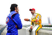 30 March - 1 April, 2012, Birmingham, Alabama USA.Tony Kanaan and Dario Franchitti chat before first practice. .(c)2012, Jamey Price.LAT Photo USA