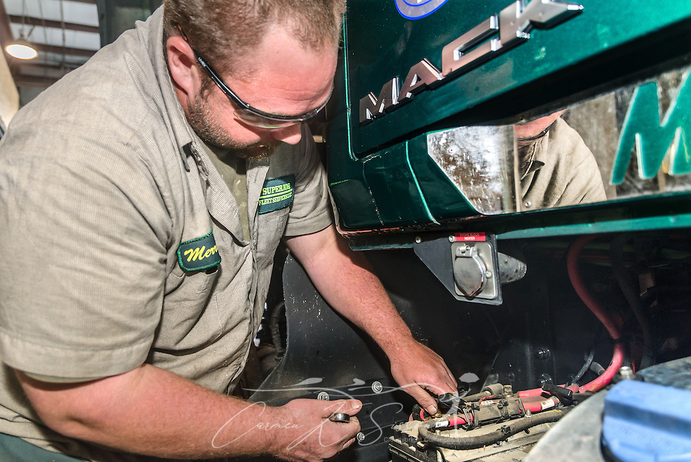 Technician Merrick Diggers performs routine maintenance on a Mack Pinnacle truck at Superior Transportation, Oct. 2, 2015, in North Charleston, South Carolina. (Photo by Carmen K. Sisson/Cloudybright)