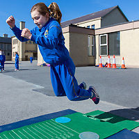 Amy Ryan shows how to do the Standing Long Jump