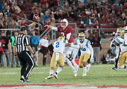 PALO ALTO, CA - SEPTEMBER 23:  K.J. Costello #3 of the Stanford Cardinal attempts a pass during an NCAA Pac-12 football game against the UCLS Bruins on September 23, 2017 at Stanford Stadium in Palo Alto, California.   Pressuring Costello are Josh Woods #2 and Nate Meadors #22 of UCLA.  (Photo by David Madison/Getty Images)