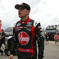 James Buescher walks to his garage after the qualifying practice session of the NASCAR Nationwide Drive4COPD 300 was cut short due to bad weather at Daytona International Speedway on Friday, February 21, 2014 in Daytona Beach, Florida.  (AP Photo/Alex Menendez)