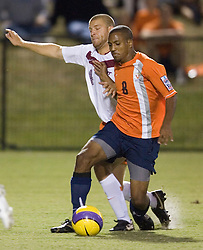 Virginia Cavaliers F/MF Ross LaBauex (8) is tackled from behind by Virginia Tech Hokies D James Shupp (4).  Shupp received a yellow card for the play.  The #4 ranked Virginia Cavaliers men's soccer team tied the Virginia Tech Hokies 1-1 at Klockner Stadium in Charlottesville, VA on September 28, 2007.